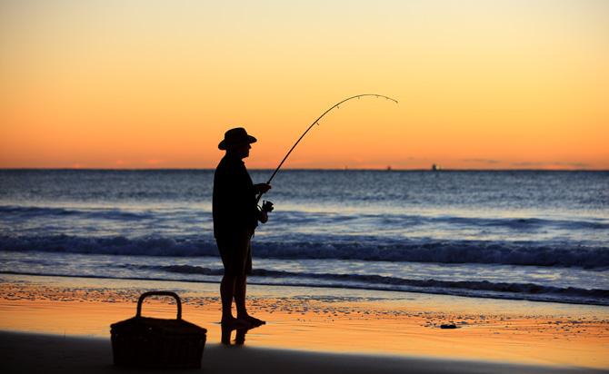 Beach Fishing at Sunset